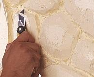 جدار من الحجر بدلا من ورق الجدران
